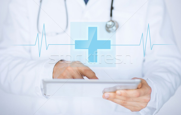 male doctor holding tablet pc with medical app Stock photo © dolgachov