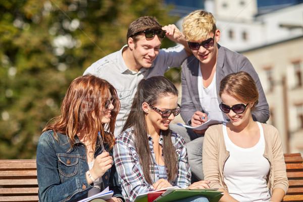 Groupe heureux élèves ordinateurs portables campus été Photo stock © dolgachov