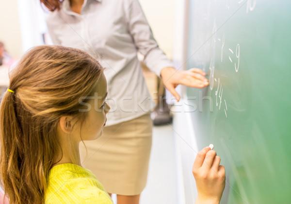 Schülerin Lehrer schriftlich Kreide Bord Bildung Stock foto © dolgachov