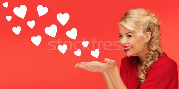 Mujer corazón formas palmas manos Foto stock © dolgachov