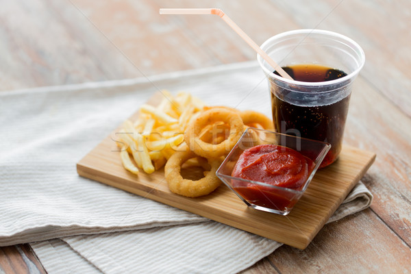 Fast-food lanches beber tabela insalubre comer Foto stock © dolgachov