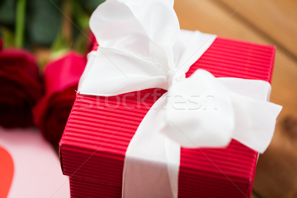 close up of red gift box with white bow Stock photo © dolgachov