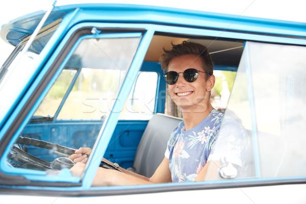 smiling young hippie man driving minivan car Stock photo © dolgachov