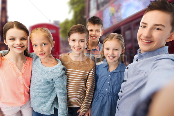 happy children talking selfie over london city Stock photo © dolgachov
