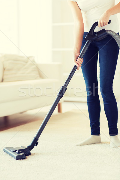 close up of woman with vacuum cleaner at home Stock photo © dolgachov