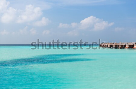 Bungalow mer eau exotique Resort plage Photo stock © dolgachov