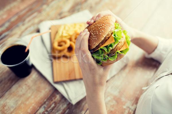 女性 手 ハンバーガー ファストフード ストックフォト © dolgachov