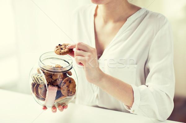 Közelkép kezek csokoládé sütik bögre emberek Stock fotó © dolgachov