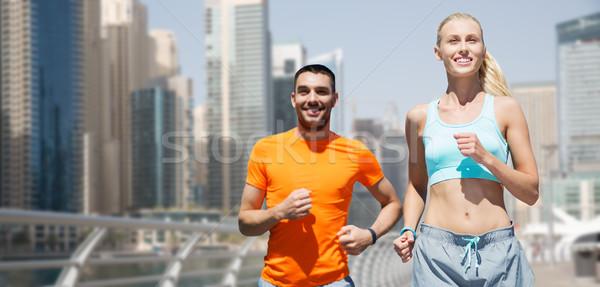Paar lopen Dubai straat fitness sport Stockfoto © dolgachov