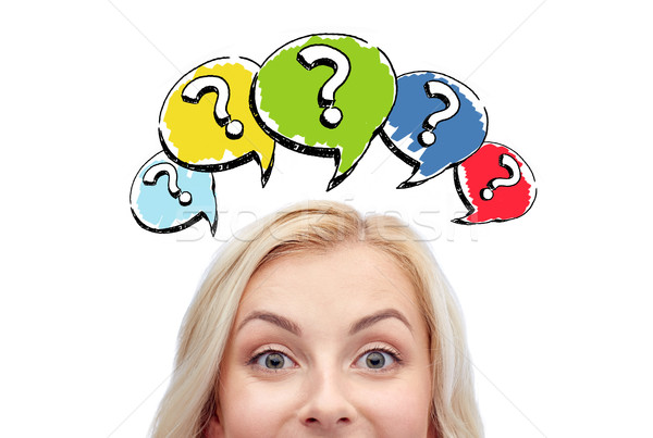 happy young woman head with question marks Stock photo © dolgachov