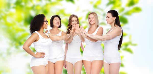 Groupe heureux différent femmes high five Photo stock © dolgachov