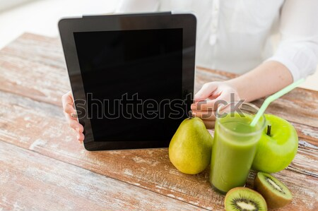 close up of woman hands tablet pc and fruit juice Stock photo © dolgachov