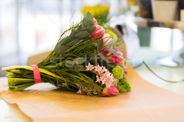 close up of bunch on paper at flower shop Stock photo © dolgachov