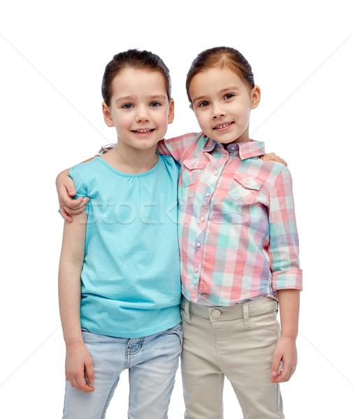 happy smiling little girls hugging Stock photo © dolgachov