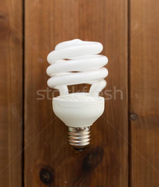 Energía ahorro iluminación bombilla madera Foto stock © dolgachov