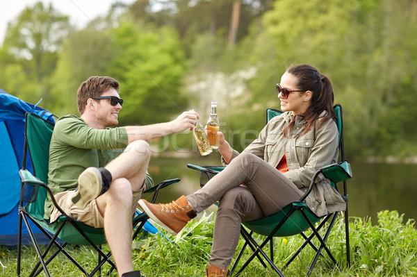 Boldog pár italok táborhely sátor kempingezés Stock fotó © dolgachov