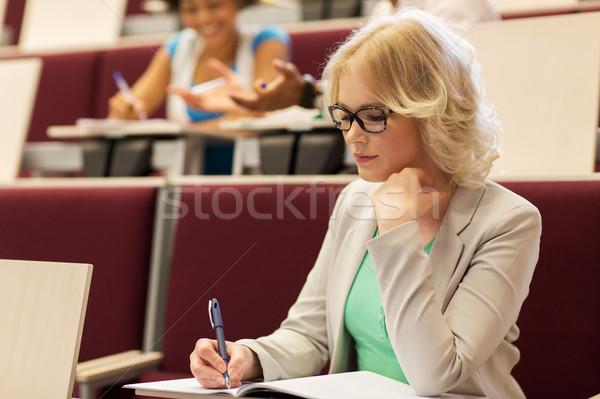 Estudante menina escrita caderno palestra ouvir Foto stock © dolgachov