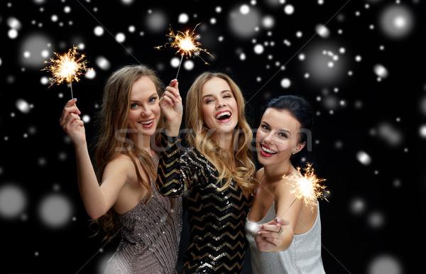 Gelukkig jonge vrouwen sneeuw nieuwjaar partij christmas Stockfoto © dolgachov