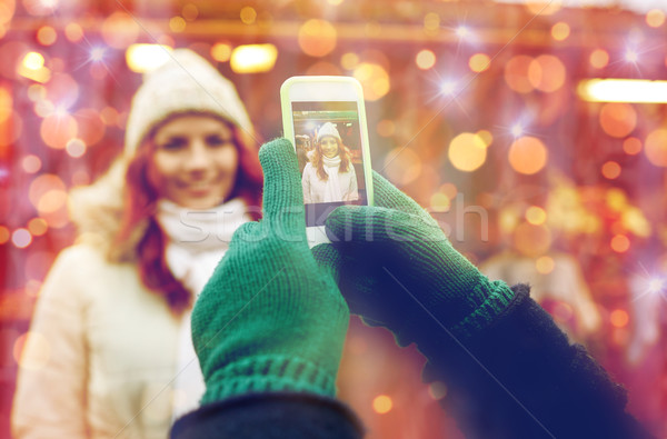 couple taking picture with smartphone in old town Stock photo © dolgachov