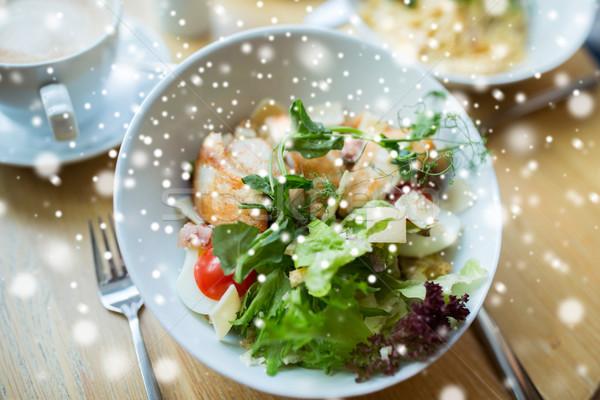 close up of caesar salad on plate at restaurant Stock photo © dolgachov