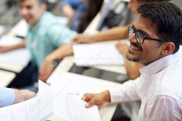 happy student with exam test or handout at lecture Stock photo © dolgachov