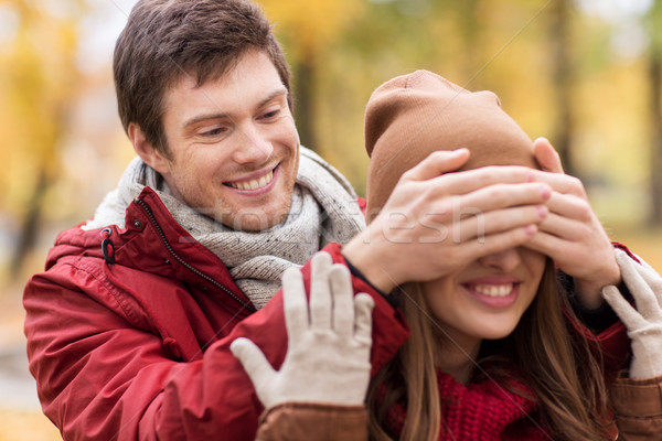 happy young couple having fun in autumn park Stock photo © dolgachov