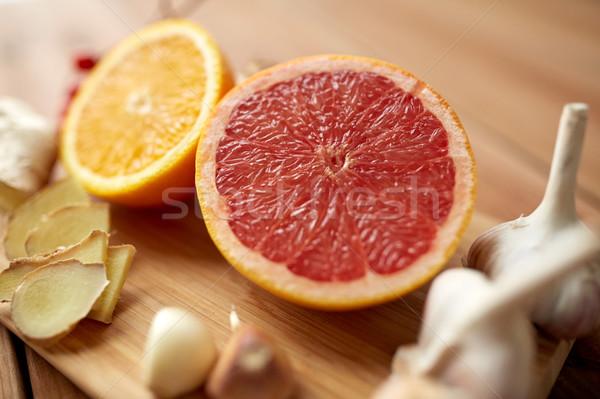 Citrus vruchten gember knoflook hout traditioneel Stockfoto © dolgachov