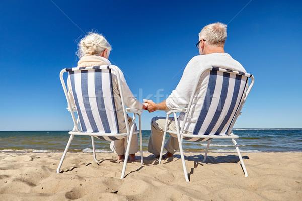 Pareja de ancianos sesión sillas verano playa familia Foto stock © dolgachov