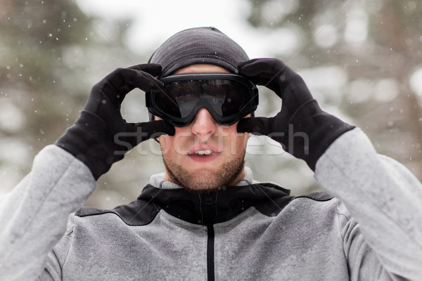 sports man with ski goggles in winter outdoors Stock photo © dolgachov