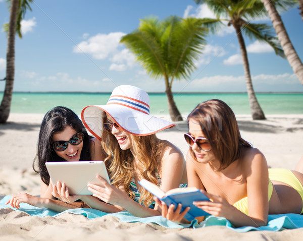 women with tablet pc and book on summer beach Stock photo © dolgachov