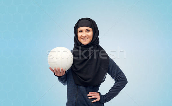 happy muslim woman in hijab with volleyball Stock photo © dolgachov