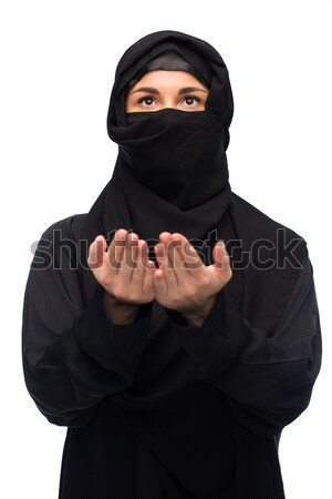muslim woman in hijab and sunglasses over white Stock photo © dolgachov