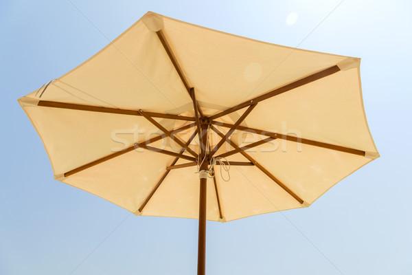 parasol over blue sky Stock photo © dolgachov
