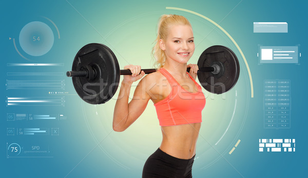 sporty young woman flexing muscles with barbell Stock photo © dolgachov