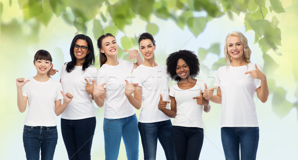 international volunteer women in white t-shirts Stock photo © dolgachov