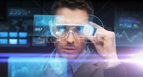 businessman in virtual reality or 3d glasses Stock photo © dolgachov