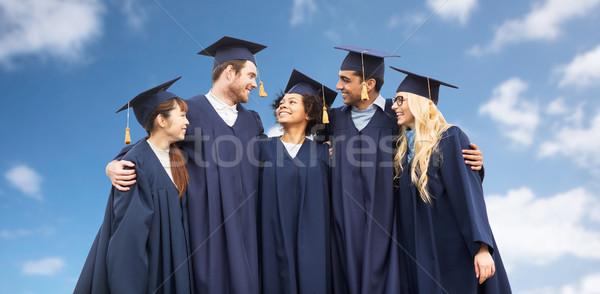 Gelukkig studenten bachelors blauwe hemel onderwijs afstuderen Stockfoto © dolgachov