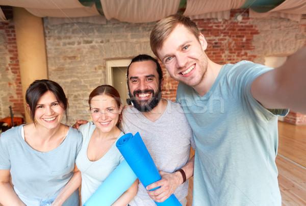 happy friends at yoga studio or gym taking selfie Stock photo © dolgachov