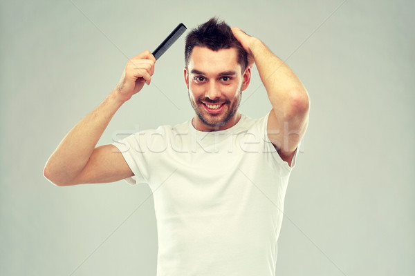 Boldog férfi haj fésű szürke szépség Stock fotó © dolgachov