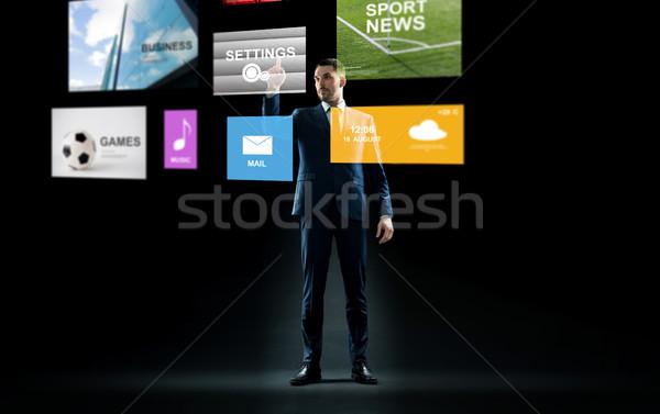businessman working with virtual applications Stock photo © dolgachov