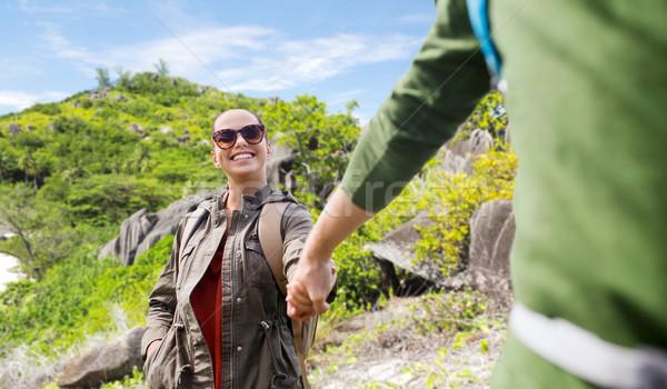 couple with backpacks traveling around island Stock photo © dolgachov