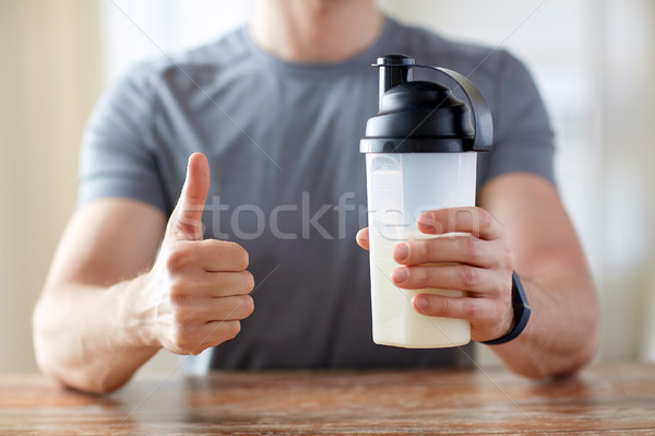 man with protein food showing thumbs up Stock photo © dolgachov