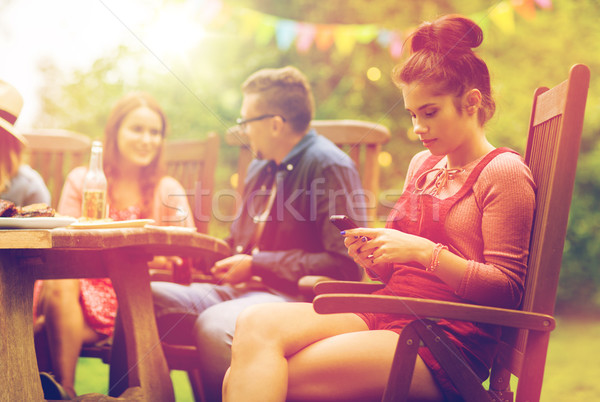 Zdjęcia stock: Kobieta · smartphone · znajomych · lata · strony · wypoczynku