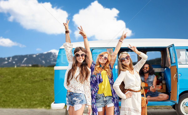 happy hippie friends at minivan car outdoors Stock photo © dolgachov