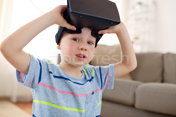Küçük erkek kulaklık 3d gözlük ev teknoloji Stok fotoğraf © dolgachov