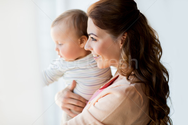 Stock photo: happy young mother with little baby at home