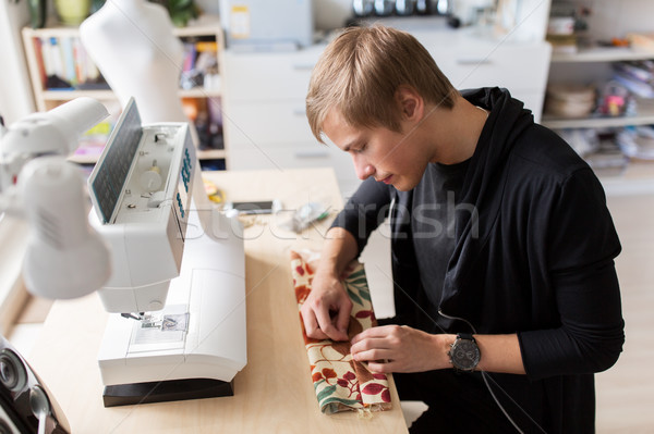 fashion designer with making dress at studio Stock photo © dolgachov