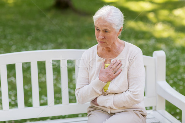 senior woman feeling sick at summer park Stock photo © dolgachov