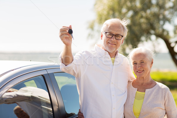 happy senior couple with car key at seaside Stock photo © dolgachov
