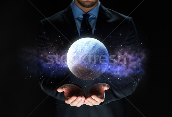 Biznesmen planety hologram działalności astronomia Zdjęcia stock © dolgachov